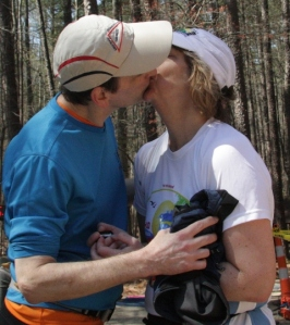 Jack Threadgill kisses his wife, Carolyn Quarterman, after she finishes her first 100-mile ultra marathon